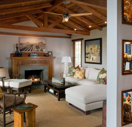 Den interior design with contemporary chaise and fireplace: Laguna Beach