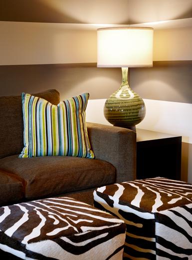 European interior designed lounge features microfiber sofa with custom ottomans: Newport Beach