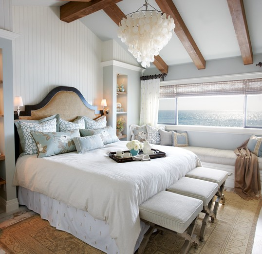 Subtle textures accompany a fabulous view in this master bedroom beachfront interior design: