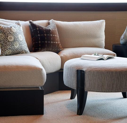 Custom uppholstry bring texture to life in this sleek interior design