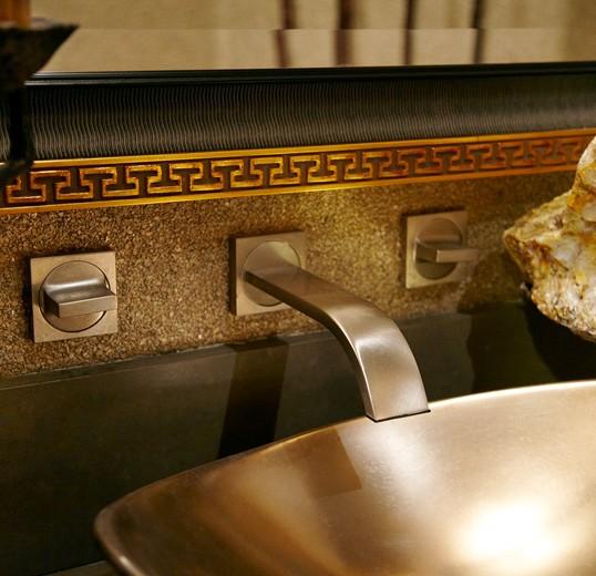 bespoke powder room sink hardware accentuates this functionally beautiful interior design