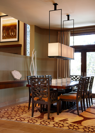 Diningroom Interior design that blends hard lines juxtaposed with winding filigree style ornamental charm
